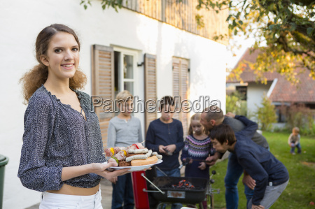 portrait of teenage girl carrying plate