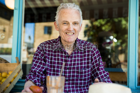 senior man relaxing at cafe