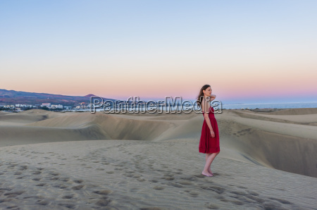 woman wearing red dress looking out