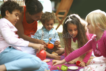 mother and four children playing picnics