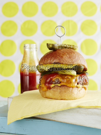 still life of cheeseburger with retro