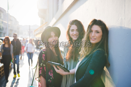 portrait of three young women using