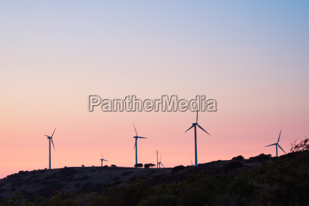 wind turbines on mountain top against