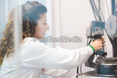 female scientist changing x ray detector