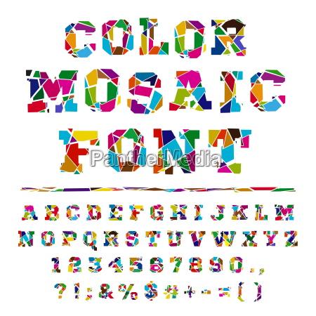 broken colored alphabet on a light