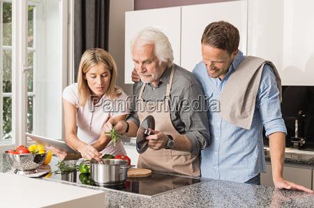 senior man with mid adult couple