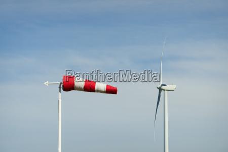 striped wind sock and wind turbine