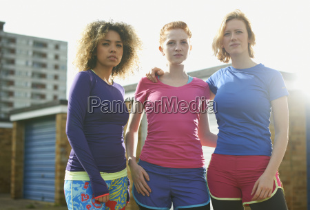 portrait of three women standing together