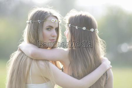 portrait of two teenage girls wearing