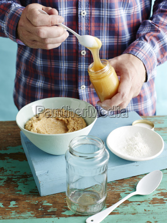 man preparing fresh mustard recipe step