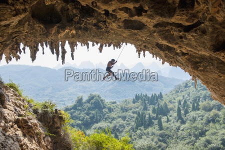 male climber taking a fall at