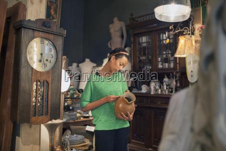 young woman looking at jug price