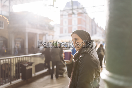 young man with takeaway coffee covent