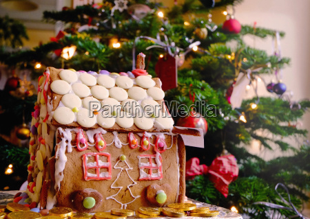 confectionery covered gingerbread house in front