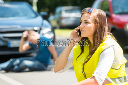 woman talking on cellphone at street