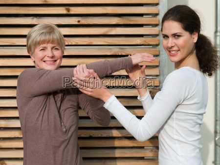 senior woman receiving physiotherapy