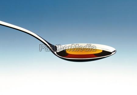 cough medicine on a spoon