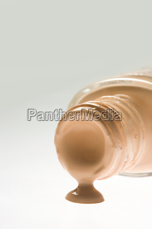 cosmetic foundation spilling out of a