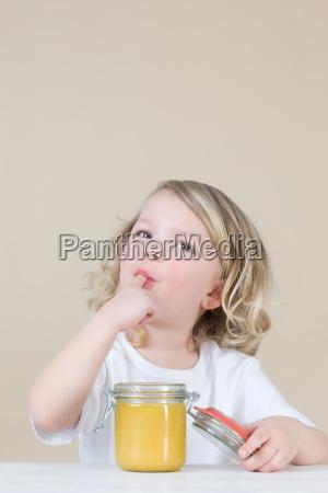 girl eating lemon curd