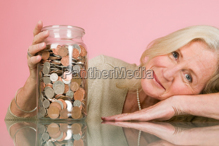 woman with coins in a jar