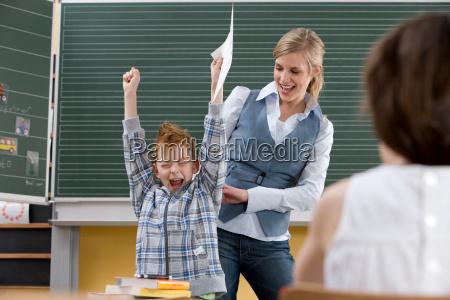 boy celebrating grade