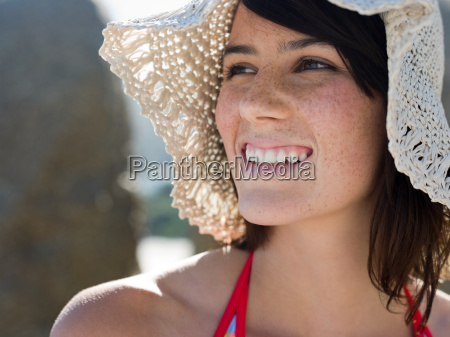 a young woman wearing a hat