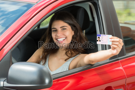 woman showing her driving license