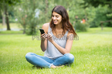 happy woman using mobile phone