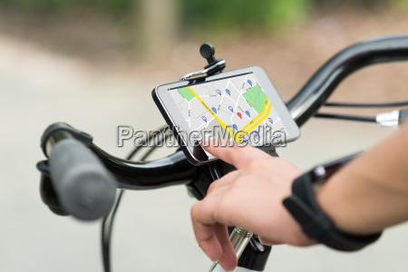 finger pointing at smart phone showing