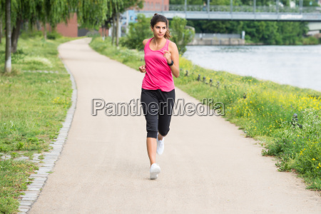 athletic young woman jogging