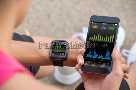 running female with mobile phone connected