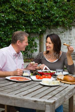 mature woman and senior man dining