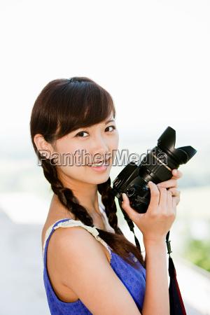 woman with camera regensburg bavaria germany