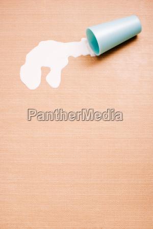 a spilt cup of milk