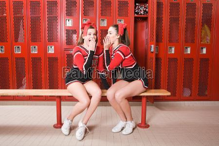 cheerleaders gossiping in locker room