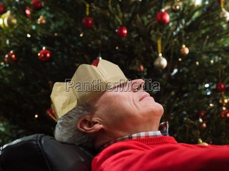 mature man sleeping in chair