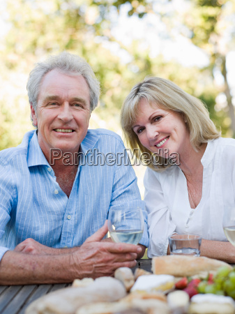 mature couple at meal outdoors
