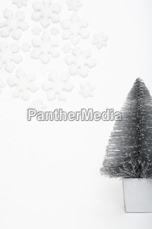 christmas tree and snowflake decorations