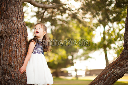 portrait of girl leaning on tree