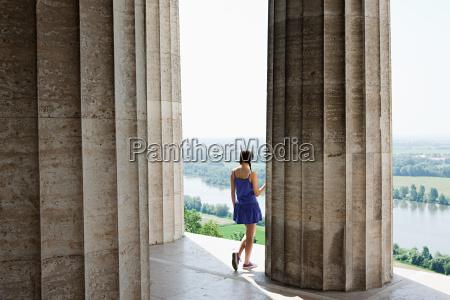 woman by stone columns regensburg bavaria