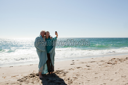couple at the beach in blanket