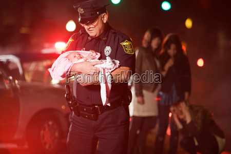 police officer rescuing a baby