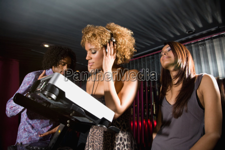 people around a dj in a