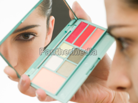 young woman with makeup mirror
