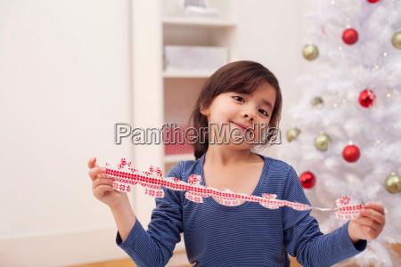 girl holding christmas decoration portrait