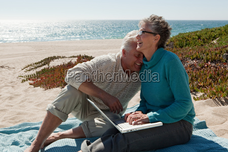 mature couple using laptop at the