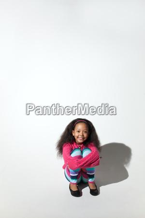 girl hugging her knees