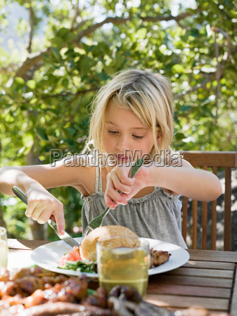 girl eating meal outdoors