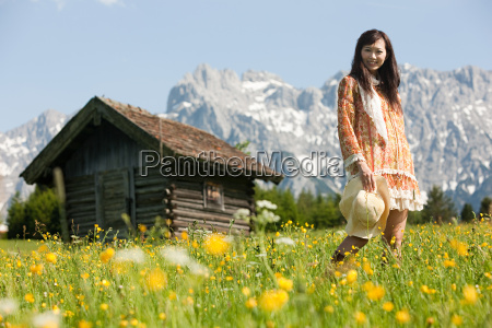 woman in meadow with bavarian alps