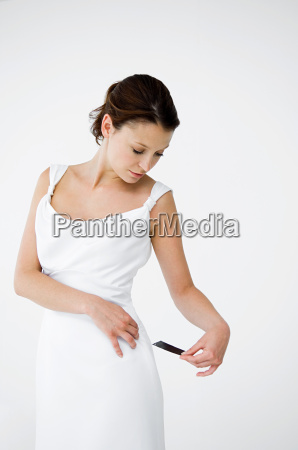 woman wearing white dress looking at